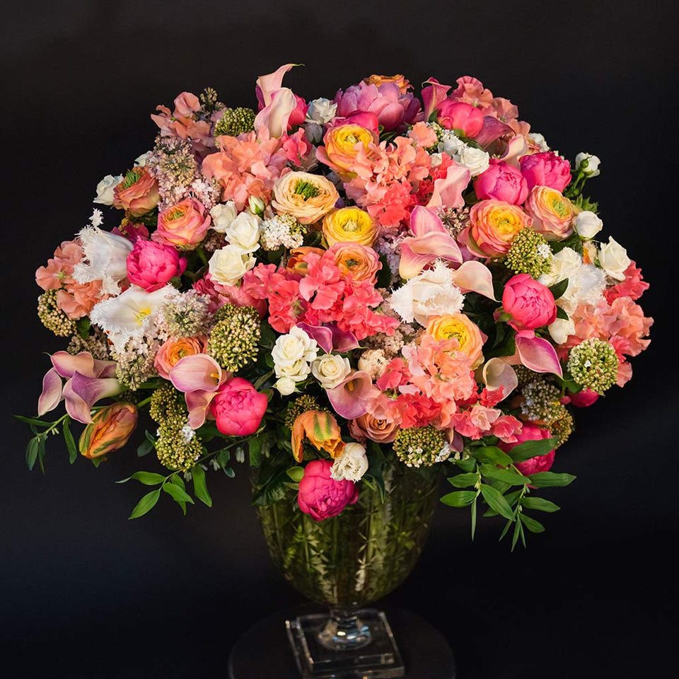 Bespoke extra-large arrangement of peonies, sweet pea, ranunculus and tulips in crystal vase