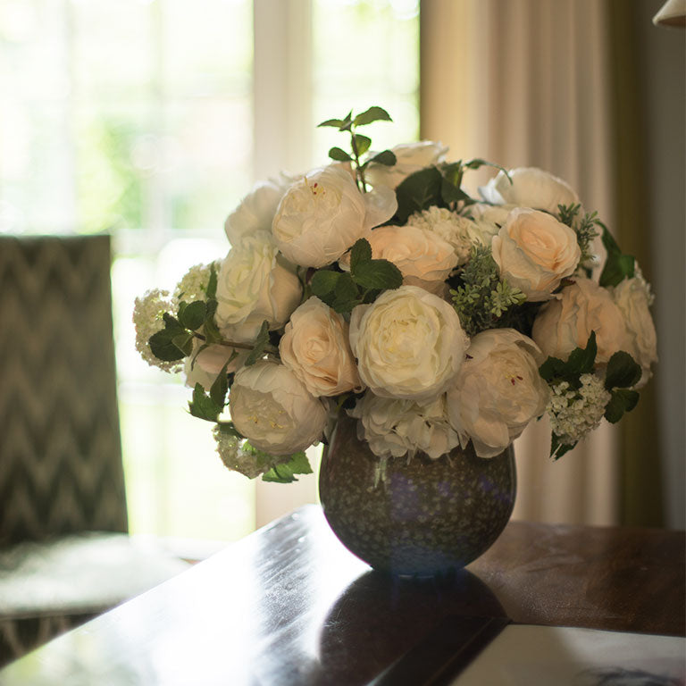 Arrangement of white & cream silk roses in speckled ceramic bowl