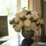 960x960**center**Arrangement of white & cream silk roses in speckled ceramic bowl **enquire