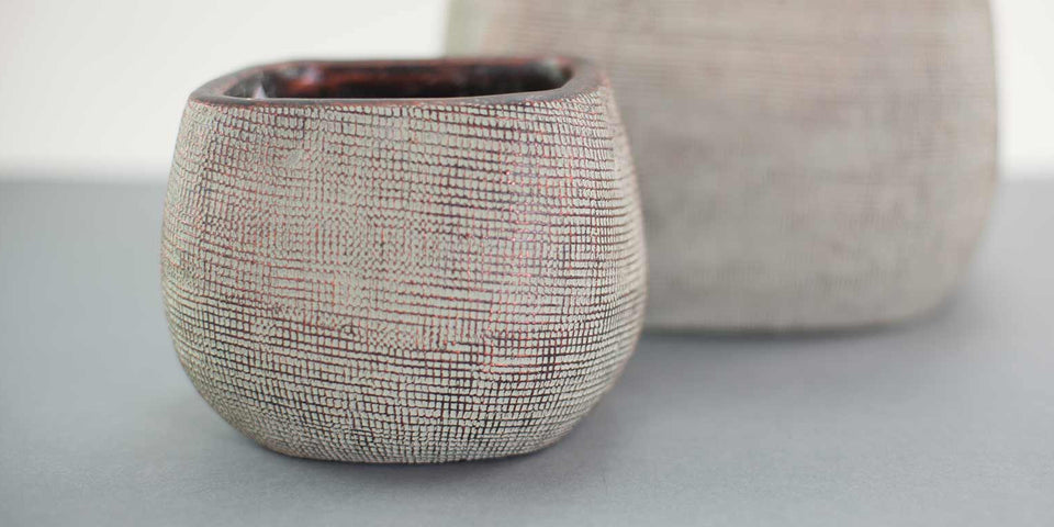 Textured white-washed square vessel