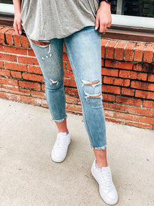 Nirvana Mid Rise Distressed Crop Skinnies