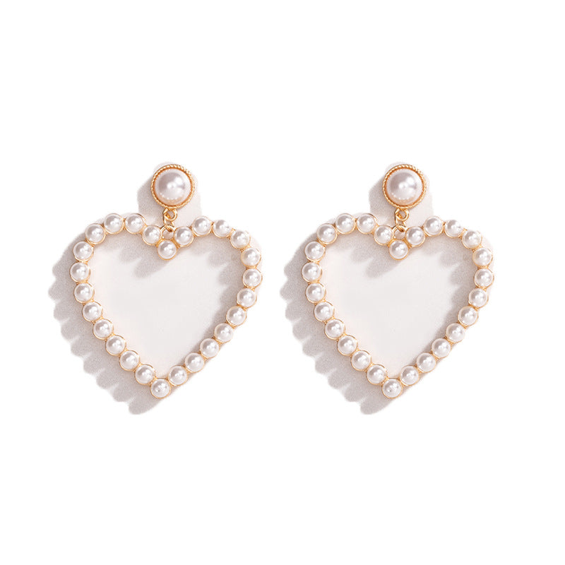 Dangle Pearl Heart Earrings in GOLD PLAIN AND GOLD PEARL | Cleoblvd