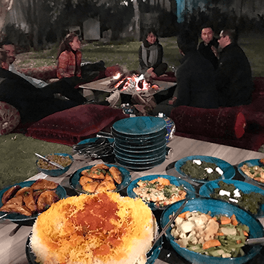 dinner by fire with afghan food and saffron rice