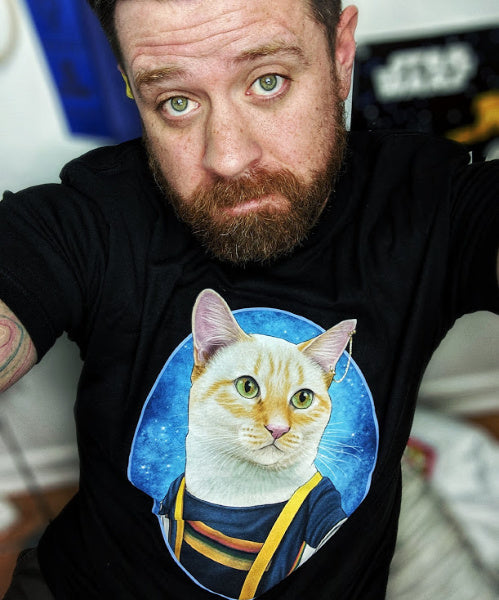 mike wearing a doctor who t-shirt with a cat in a doctor who outfit