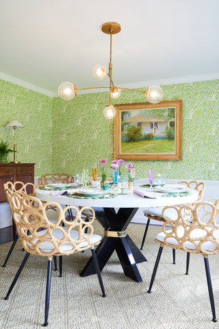 Elegant dining room furniture with a luxury dining room table, and a lighting lantern.