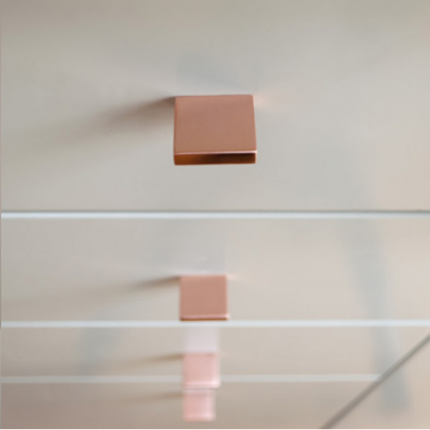 Square knob pull in polished copper. Modern and minimal.