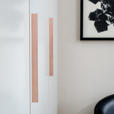 Beautiful and elegant copper handles on closet doors