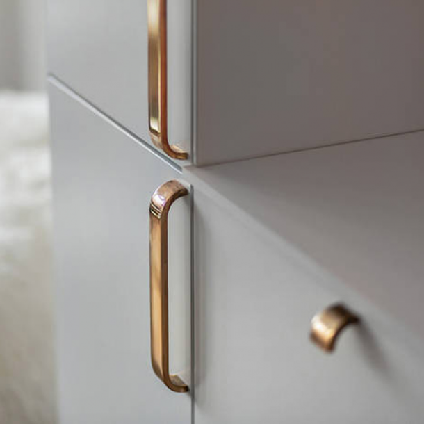 Brass curve handle and knob on modern cabinets.