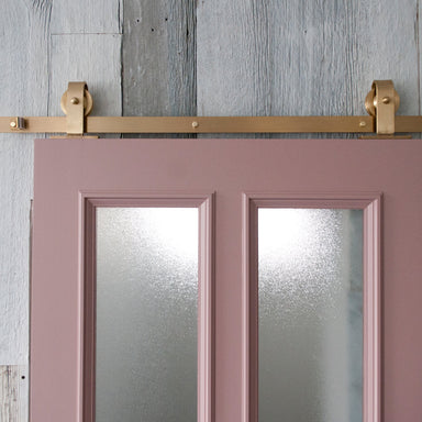 Pink Door with Brass barn door hardware