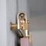 Pink Door with Brass barn door hardware detail