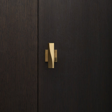 Elegant brass door knob with square rose on a dark wood door. Beautifully and functionally designed.