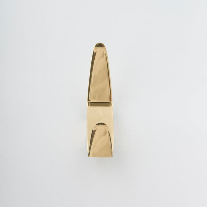 Modernist brass hook made in Toronto.