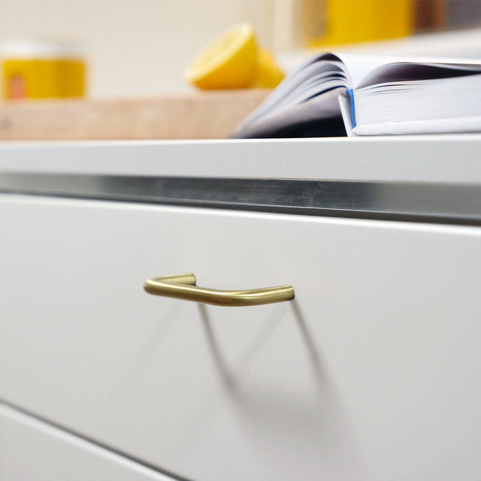 Charlie Bar Pull on modern kitchen drawer. This modern handle is made in Toronto.