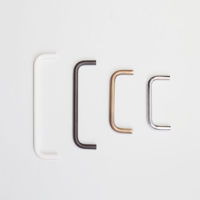 A variety of Charlie Bar Pull Handles in different sizes and finishes placed in order by size..