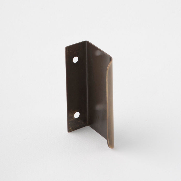 Dark brown tab pull for cabinets. Simple and minimal hardware. Made in Toronto.