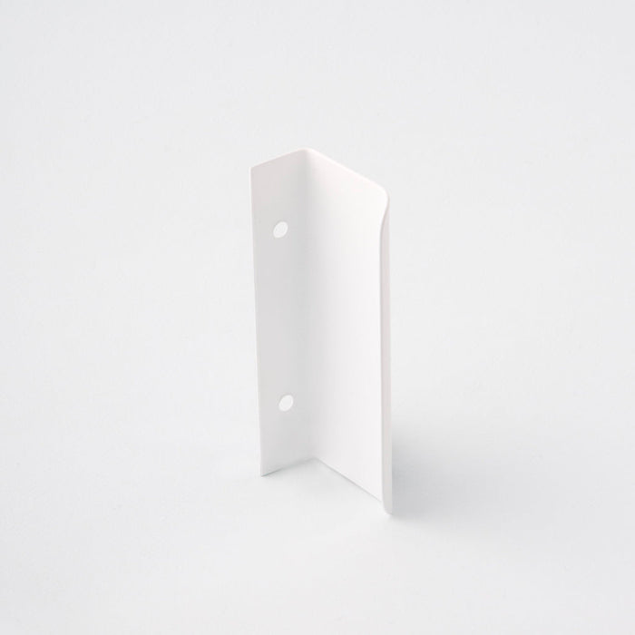 Short white tab pull for cabinets. Simple and minimal hardware. Made in Toronto. From the back.