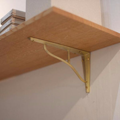 Beautiful and unique brass shelf brackets. Designed by Oji Masanori.