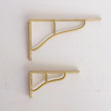 Simple and elegant shelf brackets made from cast brass. Designed by Oji Masanori.