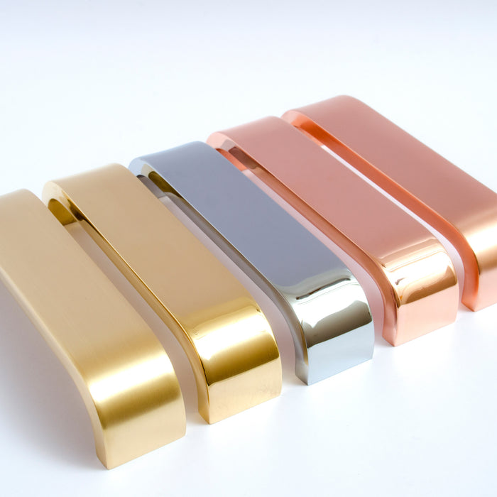 Beautiful solid handles from the Curve series. Brass, copper, and chrome.