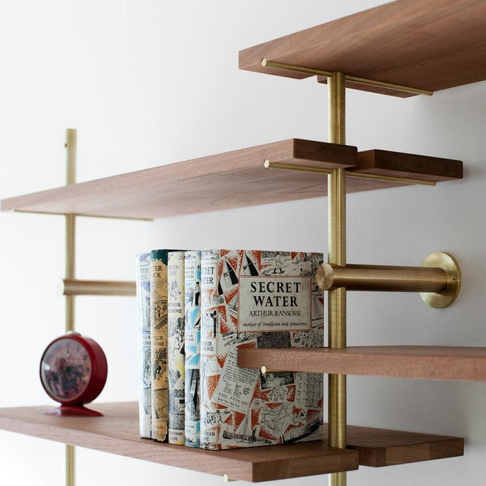Beautiful brass and wood modular shelving