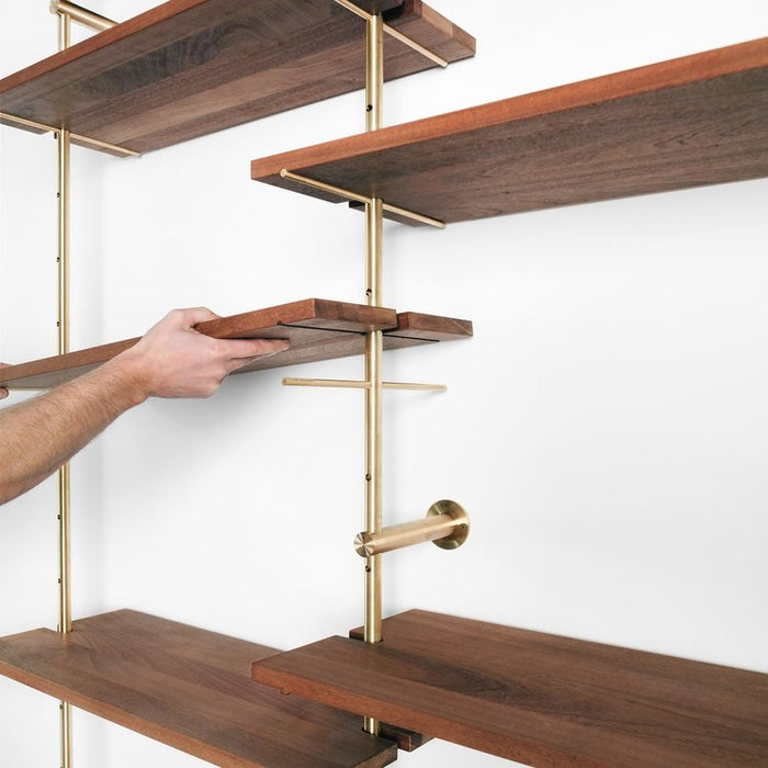 Detail of brass and wood shelving
