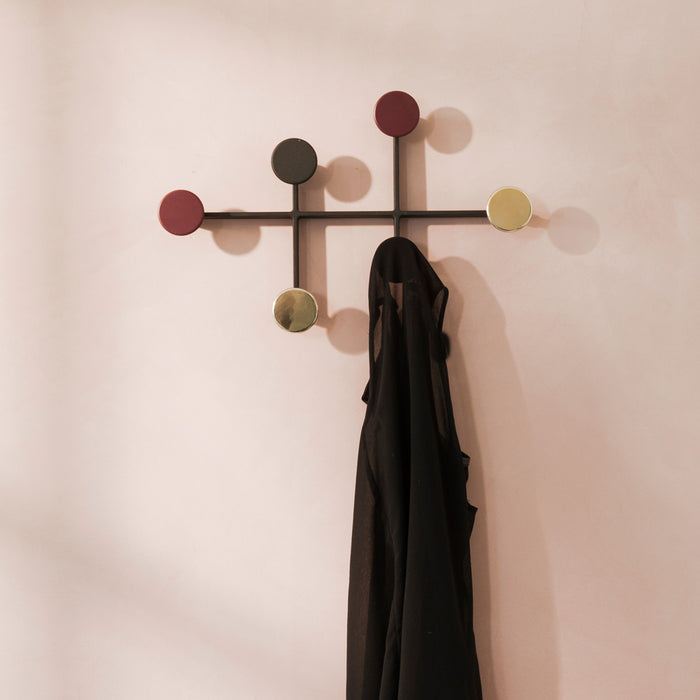 Fun and playful coat rack. Modern in design.