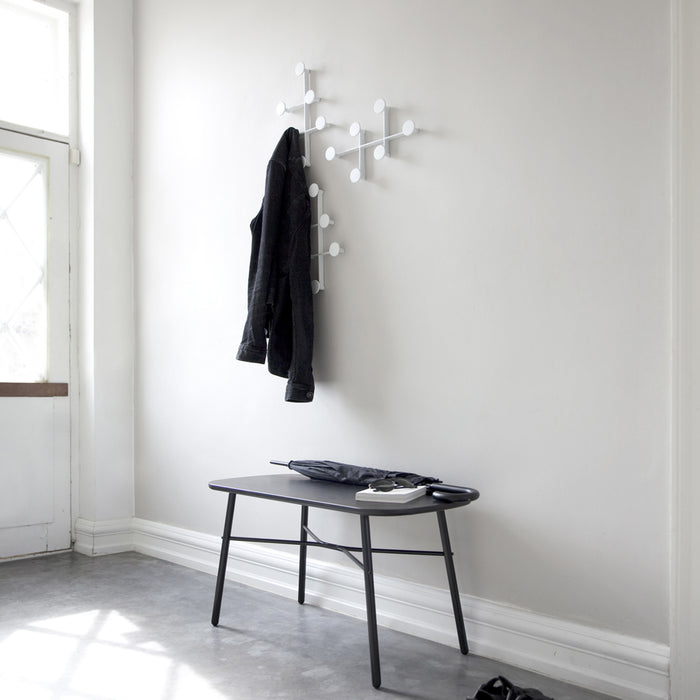 Coat Hanger in Entry with Bench. White and minimal rack design.