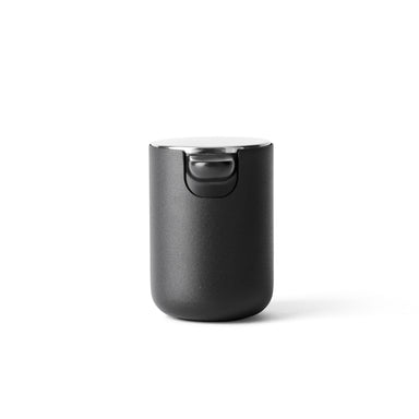 Made of stainless and  powder coated steel, this modern soap dispenser is designed by Menu.