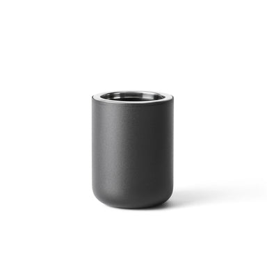 A modern toothbrush holder made of stainless steel and powder coated in matte black.