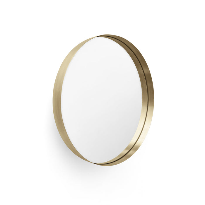 A minimal wall mirror within a brass bowl.