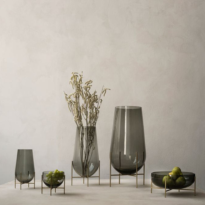 A beautiful arrangement of the Echasse collection together. Smoked glass married perfectly with bronze legs.
