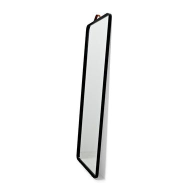 Side View of matte black frame mirror for bathroom. Designed by Norm Architects for Menu.
