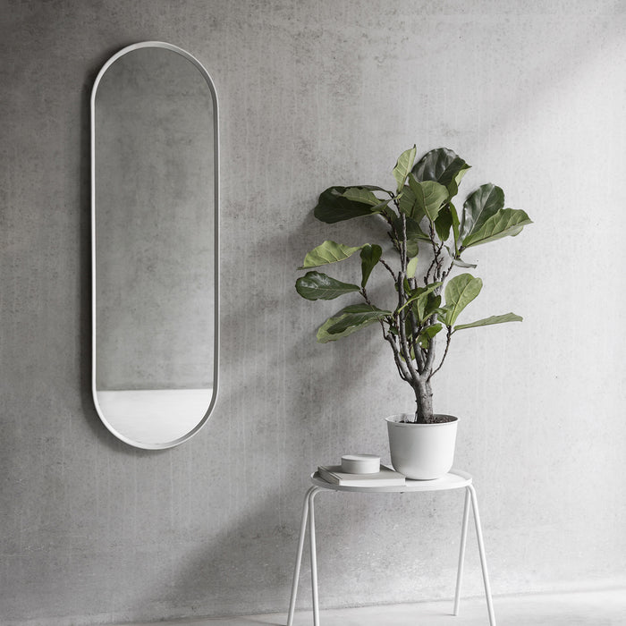 Inspired by vintage dressing room mirrors, the Norm Oval Wall Mirror offers a beautiful aesthetic for any room.