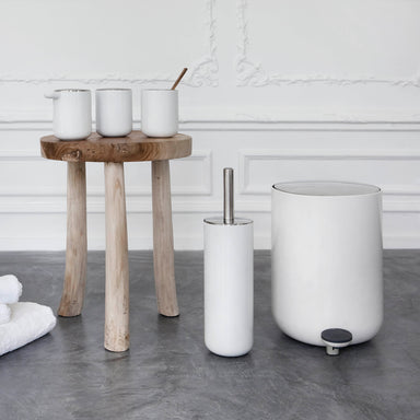 Designed for Menu, these bath items, offered in white, are available as a collection.