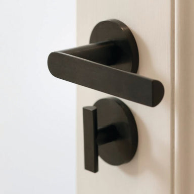 Modern Arc Door hardware in black by Piet Boon