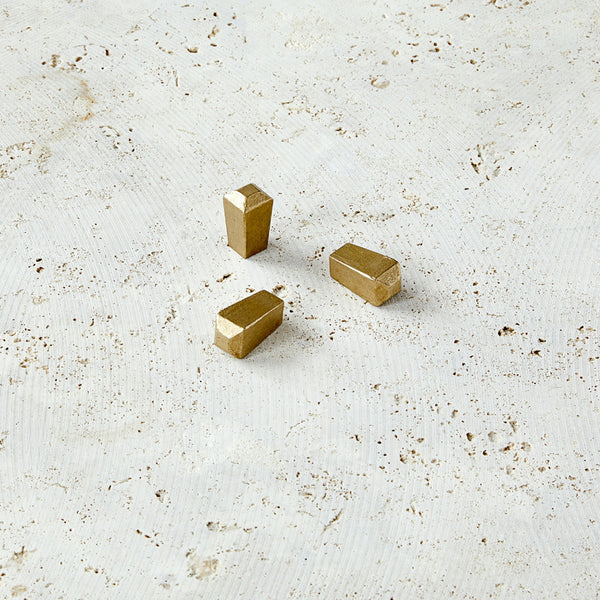 Pyramidal shaped knobs in cast bronze