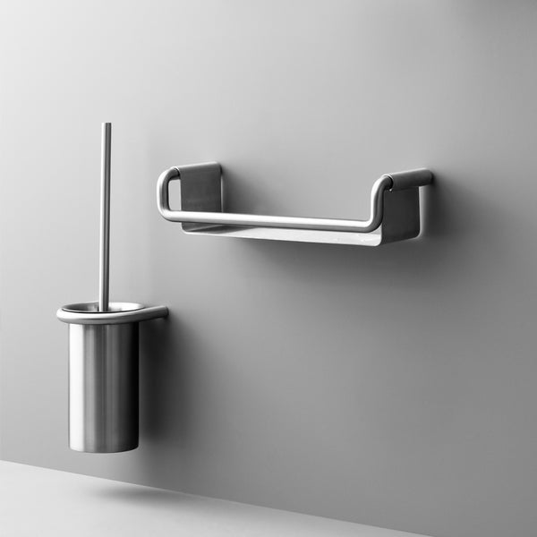 The Knud Toilet Brush Holder is part of the sanitary line by d line and is available in the following finishes: dusty grey, telegray, black, white, polished stainless, satin stainless, copper, pvd brass, pvd charcoal and gunmetal.