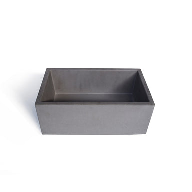 Square concrete vessel sinks. Over counter basins made of concrete.