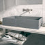 Modern bathroom counter with concrete sink.
