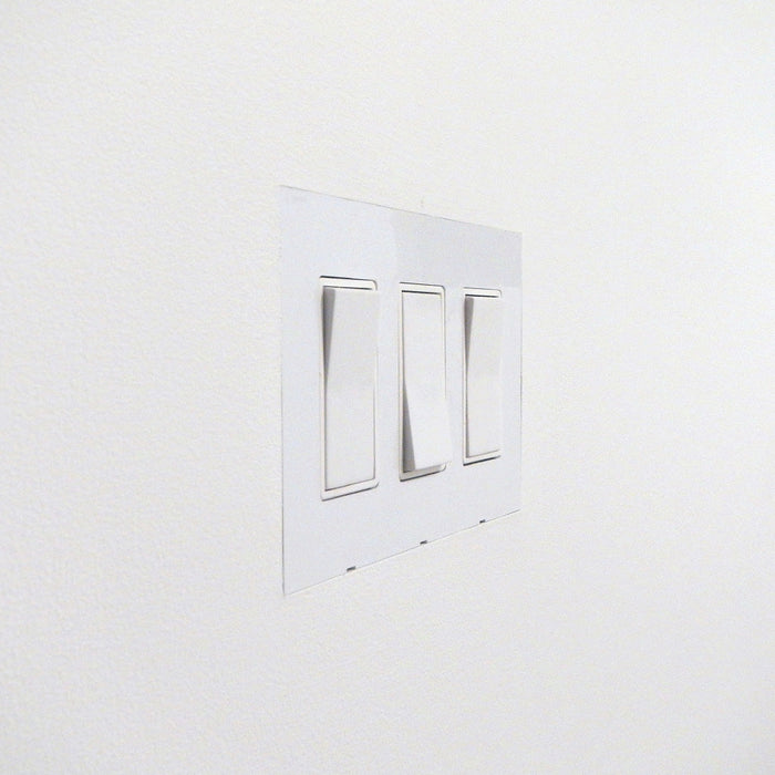Smoothline Flush recessed wall outlet plate. Minimal architectural detail. By Designmod