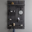 Blackened wood shelving unit