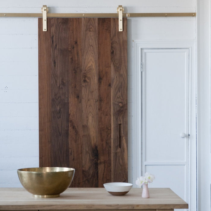 Beautiful modern and contemporary brass barn door hardware. Made in Canada