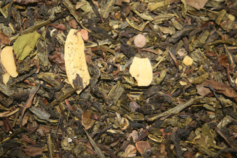 Roasted Almond (Organic) - Green oolong tea, organic green China Sencha and Pai Mu Tan tea blended with almond flakes, nut crunch, coconut chips and cinnamon.  2 oz.