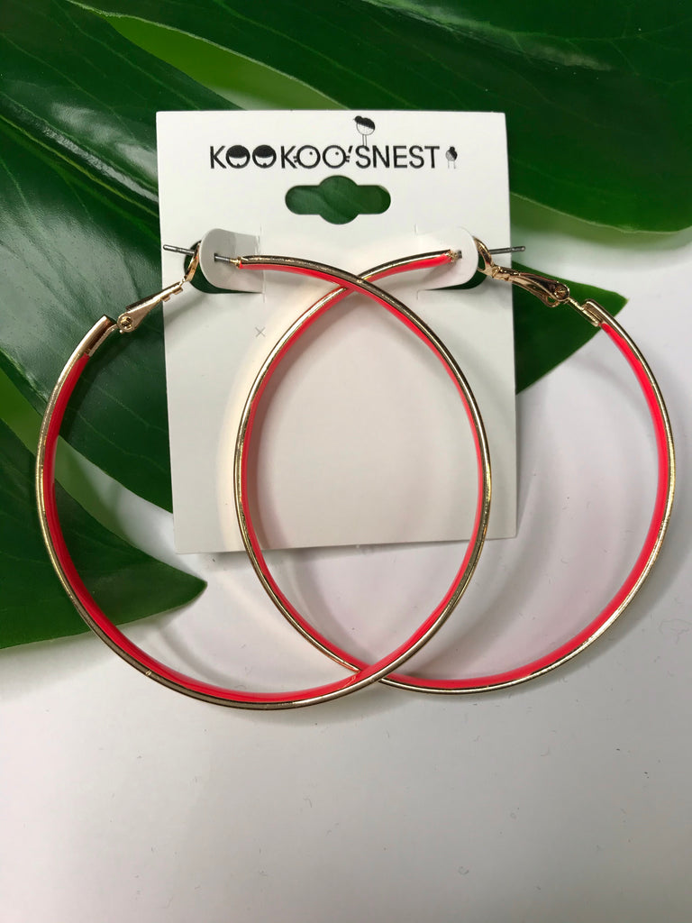 Gold hoop with neon coral interior
