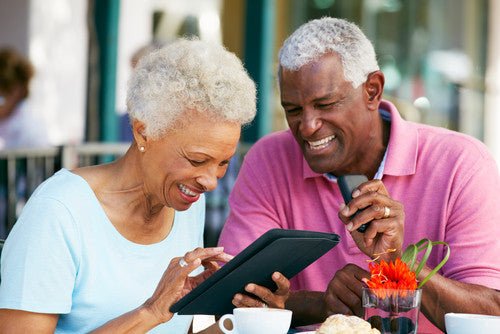 Happy-senior-couple-on-tablet