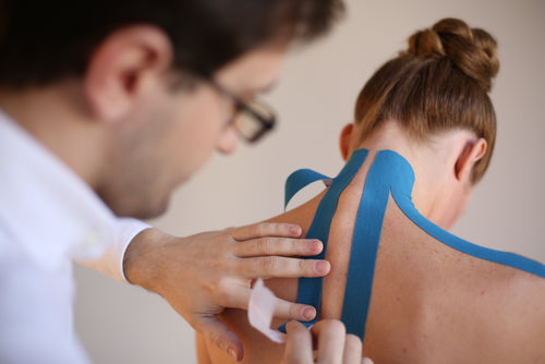 athletic-sports-tape-on-the-back-and-neck-of-a-young-woman