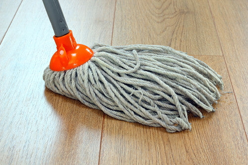 detail-of-a-mop-cleaning-wooden-floor