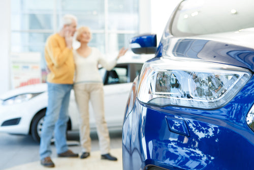 senior couple buying car