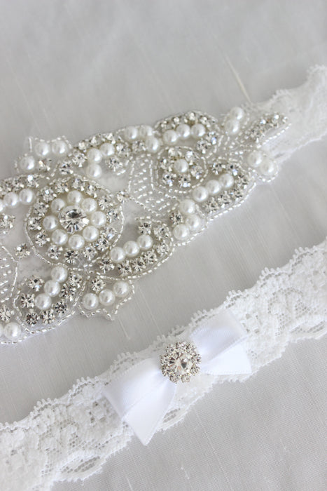 white lace wedding garter, bridal accessories australia, bling crystal pearl wedding garter luxury wedding, luxury garter, lace garter set, crystal bridal garter, white wedding garter, bridal lingerie, bridal boudoir shoot, bow garter, blush underlay wedding gown, white lace garters