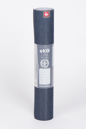 SEA YOGI // eko Lite yoga mat in 4mm and midnight style by Manduka, Online Yoga Shop, standing